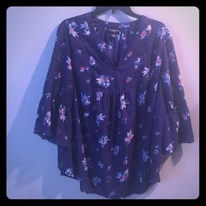 Sheer blue shirt with flower embellishments